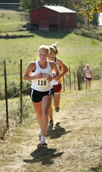 Dobyns-Bennett Kendra Sokol runs up the hill behind Daniel Boone High School during the 5K Class AAA run. Sokol placed second. Photo by Erica Yoon