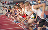 Runners break from the start of the boys 1600 meters. Photo by Ned Jilton II