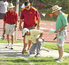 Meet officials confirm the measurment on the throw of Nik Huffman in the discus for a new meet record. Photo by Ned Jilton II