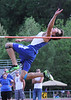 Thomas Walker's Tyler Scott jumps over the bar during the boys high jump event.
