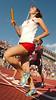 Daniel Boone runner holds a slight edge during the girls 4X800 meters race. Photoby ned Jilton II