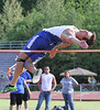 Thomas Walker's Tyler Scott stretches over the bar during the boys high jump event.