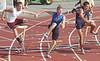 Volunteer's Sam Barton, center, knocks down hurdle but still wins the boys 110 meter hurdles. Photo by Ned Jilton II