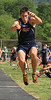 Sullivan East's Cliff Hawkins jumps during the boys long jumps event.