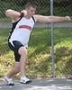 Virginia High's Nik Huffman prepares to throw during the boys shot put event.