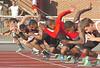 Runners break from the start of the boys 100 meters. Photo by Ned JIlton II