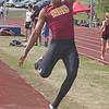 Science Hill's Elijah Mathes during the Big 7 long jump compition. Photo by Ned Jilton II