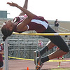 """THS' Gudger clears 5' 6"""" to win girls high jump. Photo by Ned Jilton II"""