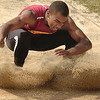 Science Hill's Elijah Mathes lands in the pit during the Big 7 long jump compition. Photo by Ned Jilton II