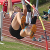 D-B's Jamie Almeria rides the pole during girls pole-vault. Photo by Ned Jilton II