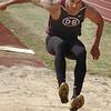 Dobyns Bennett's DJ Jones lands in the long jump pit. Photo by ned Jilton II