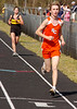 The Boys and Girls 3200 meters was run together, Sullivan Centrals Aaron Longworth, closest to the camera, would win the boys event while Sullivan North's Tasha Harris, behind in the photo would win the girls. Photo by Ned Jilton II