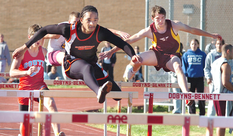 Elizabethton hurdler takes early lead in 110 meter hurdles and goes on to win during Tom Coughenour Invitational Track meet at Dobyns Bennett. Photo by Ned Jilton II