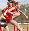 Amanda Patterson of Sullivan South takes the early lead in the girls 100 meter hurdles. Photo by Ned Jilton II