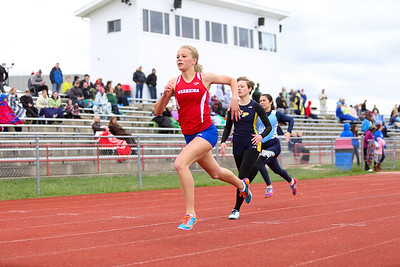 "Ken Kadwell/@KenKadwell - Special to the Sun Chippewa Hills' Nicole Snyder leads her heat in the 200 meter dash at Chippewa Hills Friday, May 16, 2014.  ""We'll do good,"" said Snyder of her team."
