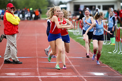 "Ken Kadwell/@KenKadwell - Special to the Sun Chippewa Hills' Emily Starck hands the baton to Kylie Schafer in the four by 800 meter relay at Chippewa Hills Friday, May 16, 2014.  ""I just saw those two girls ahead of me and I just wanted to get them,"" said Starck."