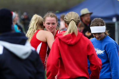 "Ken Kadwell/@KenKadwell - Special to the Sun The Chippewa Hills' girls four by 800 meter relay team greet and hug teammate Megan O'Neil after placing first at Chippewa Hills Friday, May 16, 2014.  ""Are team is really excited to go to states,"" said O'Neil."