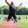 Record-Eagle/Brett A. Sommers Traverse City Central's Antoine Ricardo competes in the long jump at Wednesday's Golden Baton track and field meet at Traverse City West.