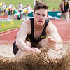 Record-Eagle/Brett A. Sommers Traverse City Central's Noah Norton competes in the long jump at Wednesday's Golden Baton track and field meet at Traverse City West.