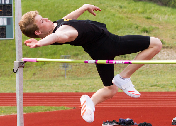 Record-Eagle/Brett A. Sommers Traverse City Central's Nathan Kolosar competes in the high jump at Wednesday's Golden Baton track and field meet at Traverse City West.