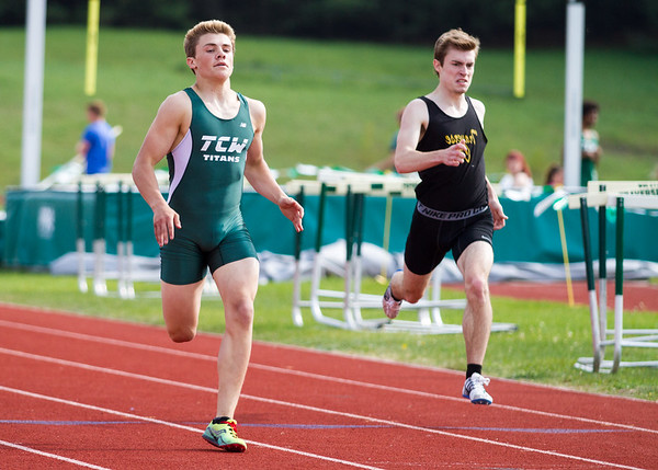 Record-Eagle/Brett A. Sommers Traverse City West's Wylie Edick wins the 400-meter dash during Wednesday's Golden Baton track and field meet at TC West.