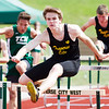 Record-Eagle/Brett A. Sommers Traverse City Central's Will Barnes competes in the 110 high hurdles at Wednesday's Golden Baton track and field meet at Traverse City West.