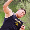 Record-Eagle/Brett A. Sommers Traverse City Central's Walker Chung competes in the shot put at Wednesday's Golden Baton track and field meet at Traverse City West.
