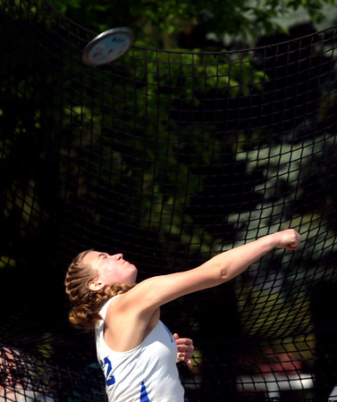 WARREN DILLAWAY | Star Beacon<br /> Becca Martin of Madison releases the discus  on Friday morning at Hilliard Darby High School during the Division I Ohio High School Athletic Association Track Meet in Columbus.