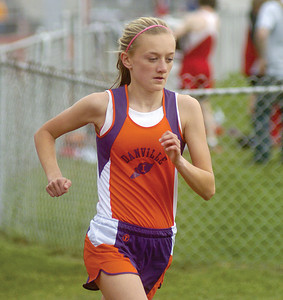 Danville's Alison Billas runs the mile during Tuesday meet at Mount Carmel.