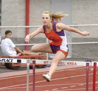 Sarah Haney runs the hurdles on Tuesday at Mount Carmel.