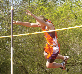 Danville's Tyler Jani clears the bar during Tuesday's pole vault competition at Mount Carmel.