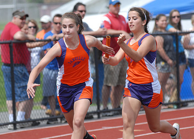 Danville's Christina Murphy, right, hands off to Sara Naessig in the 4x100 relay during the league meet Saturday May 12, 2012 at Shikellamy.