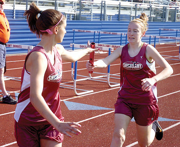 Shikellamy's Rachel Pontius receives the baton from Courtney Lahr during the 3200m realy.