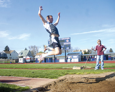 Leander Cortolezis in the middle of his high jump attempt on Tuesday afternoon.