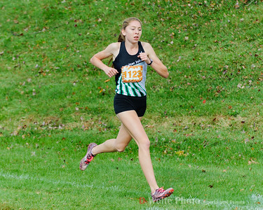 Wearing bib number 1123, Abigail Green finshes the Varsity Girls Cross Country Championships for Montgomery County with a time of 17:46.6