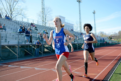 Selinsgrove's Ashley Blair leads the 1600 as Shikellamy's Treicy Cedeno follows closely behind during Tuesday's meet.