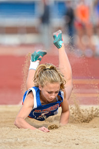 Selinsgrove's Megan Hoffman goes face first into the sand after landing her long jump attempt during Tuesday's meet against Danville.