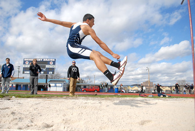Shikellamy's Shawn Turber competes in the long jump event at Tuesday's home track meet against Lewisburg.