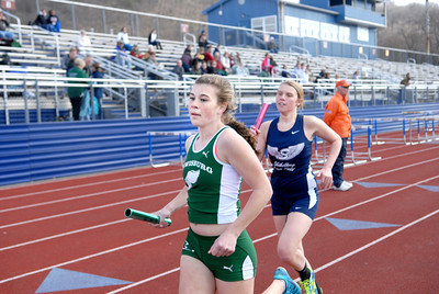Lewisburg's Katie Edwards, left, leads Shikellamy's Sierra Strouse around the track after the first lap in the 4x800 relay at Tuesday's track meet.