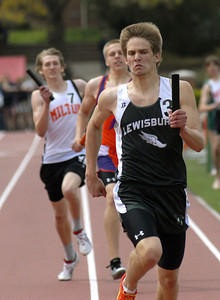 Lewisburg's Adam Slear pushes for the finish line and a win in the boys 4x400 relay at the Susquehanna High School Classic Saturday April 14, 2012.