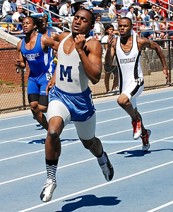 Marietta's Woodrow Randall competes in the 100 meter dash Saturday afternoon during the Marietta Invitational.