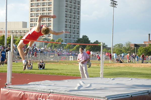 Teenage boy high jumper