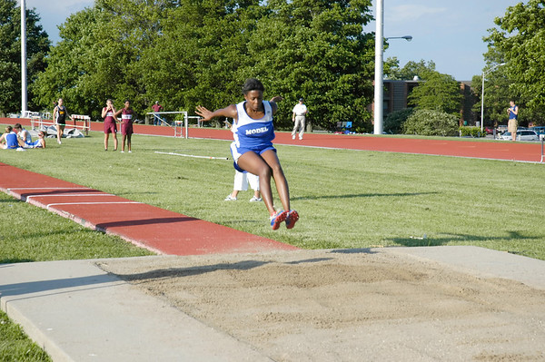 Teenage girl in triple jump