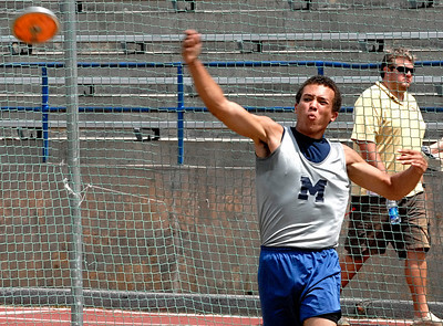 Marietta's Kristopher Leverette releases the discus Thursday afternoon during the boys state track meet at Memorial Stadium in Jefferson.