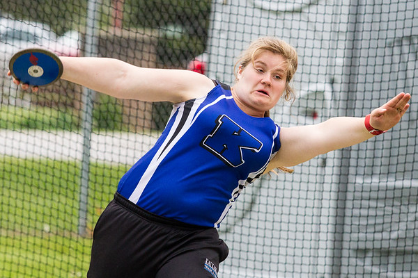 Record-Eagle/Brett A. Sommers Kalkaska's Hannah Lapan competes in the discus during Wednesday's Lake Michigan Conference Championship track and field meet at Elk Rapids HIgh School. Lapan's top throw was a personal-best 65 feet, five inches.
