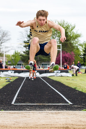 Record-Eagle/Brett A. Sommers Traverse City St. Francis' Andy Simaz competes in the long jump during Wednesday's Lake Michigan Conference Championship track and field meet at Elk Rapids High School. Simaz's top jump was 17 feet, six inches.