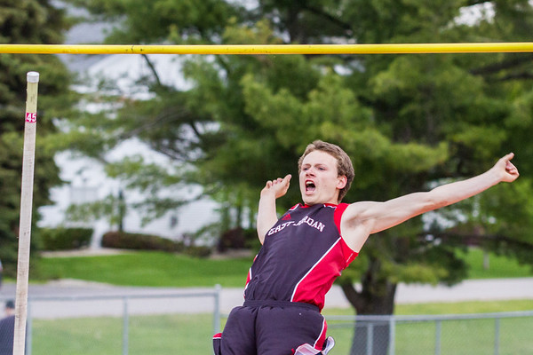 Record-Eagle/Brett A. Sommers East Jordan's Dylan Holm competes in the pole vault during Wednesday's Lake Michigan Conference Championship track and field meet at Elk Rapids High School. Holm won the event and set a school record with a vault of 13 feet.