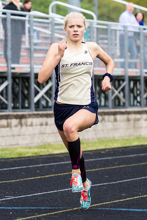 Record-Eagle/Brett A. Sommers Traverse City St. Francis' Emmalyne Tarsa competes in the 400-meter run during Wednesday's Lake Michigan Conference Championship track and field meet at Elk Rapids HIgh School. Tarsa won the event with a personal-best time of 58.73 seconds.