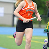 Gardner High School sophomore Mallory Thompson competes in the 4x800 at Lunenburg High School on Thursday afternoon. SENTINEL & ENTERPRISE/JOHN LOVE