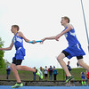 Lunenburg High school eighth grader Christopher McCauliff hands off the baton to his teammate freshman Robby Brand as they compete in the 4x800 at Lunenburg High School on Thursday afternoon. SENTINEL & ENTERPRISE/JOHN LOVE